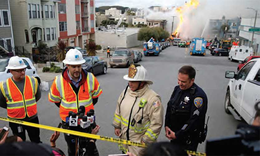 Pacific Gas & Electric spokesman Paul Doherty, second from left, and San Francisco Fire Department Chief Joanne Hayes-White, second from right, spoke as firefighters battled a fire sparked by a ruptured gas line in San Francisco in February.